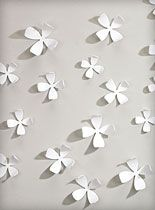White Dogwood Wallflowers 3-D Art at PLASTICLAND. I have a set of these in my bedroom, and they are fantastic! I painted half of them blue and added a light coating of clear glitter. The other half I left white, and then intermingled the two on the wall behind my bed.