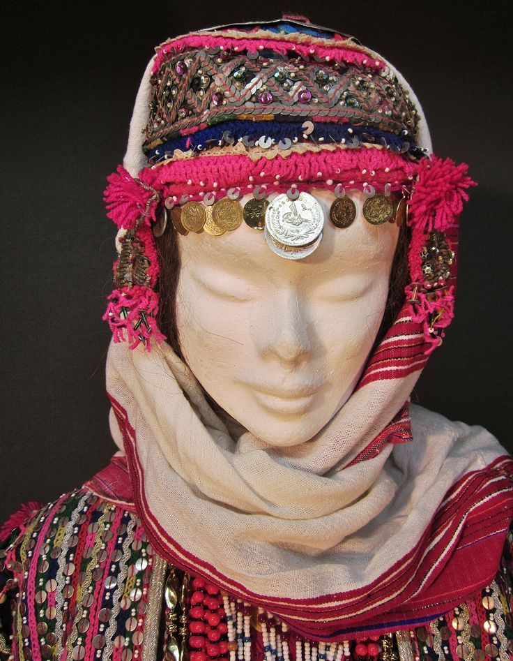 A traditional festive headgear from the Pomak villages near Biga (Çanakkale prov.).  Setting for married women.  Mid-20th century.  The cap is adorned with metal sequins, glass beads, metal (imitation) Ottoman coins, (cotton or orlon) pom-poms.  (Kavak Costume Collection - Antwerpen/Belgium).