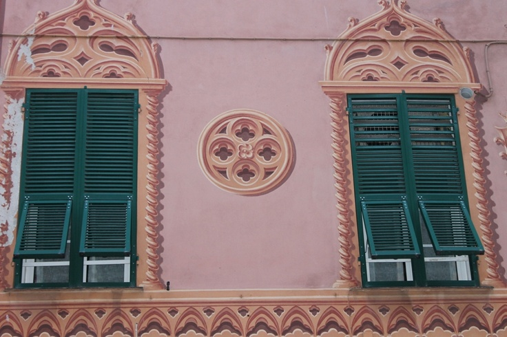 Typical Ligurian green shutters with trompe l'oeil decorations.