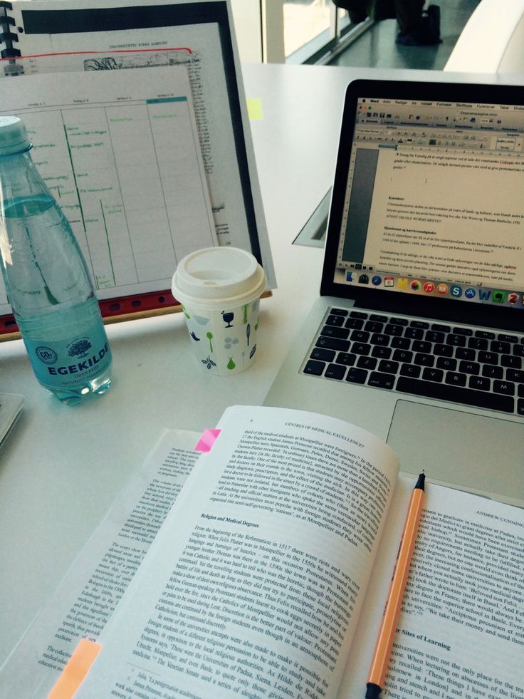 """eat-sleep-read: """" Working on my exam paper at the university library. A small coffee and lots of water to keep me going! """""""