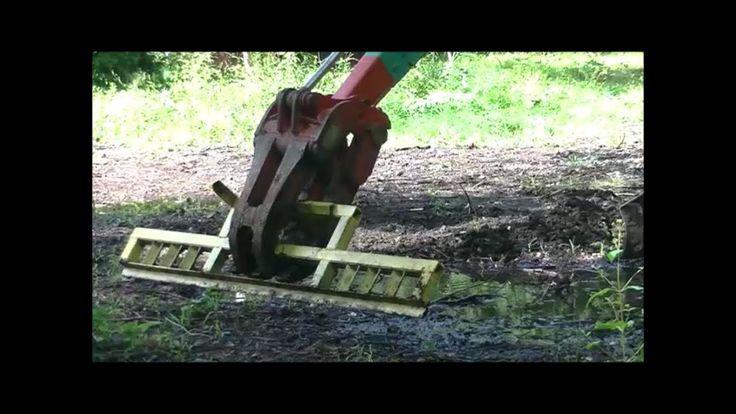 Homemade grading bar for mini excavator grapple attachment