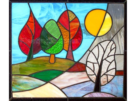 A colorful stained glass panel inspired by a change of seasons. The original panel has sold - https://www.etsy.com/transaction/48991311 - but I will be happy to make you one like that. The glass will be a close match carefully selected to depict Autumn turning into Winter. The dimensions are 20 x 18 inches. I made this panel using the copper foil or Tiffany style method - so no lead came was used. The panel has two loops on the top corners and is ready to hang. I photograp...