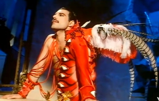 freddie mercury in a theatrical costume with feathers and eyes he would have been 66 today. Black Bedroom Furniture Sets. Home Design Ideas