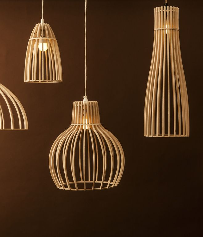 """Lighting Range by Minima Minima's new range of light coverings throw shadows rather than provide shade. Made from Austrian birch plywood, they snap together quickly. """"Light bulbs used to give such an ugly light,"""" says Minima's Jacques Cronje, who is also an architect at Timber Design in Cape Town. """"This becomes a bit more sculptural."""""""