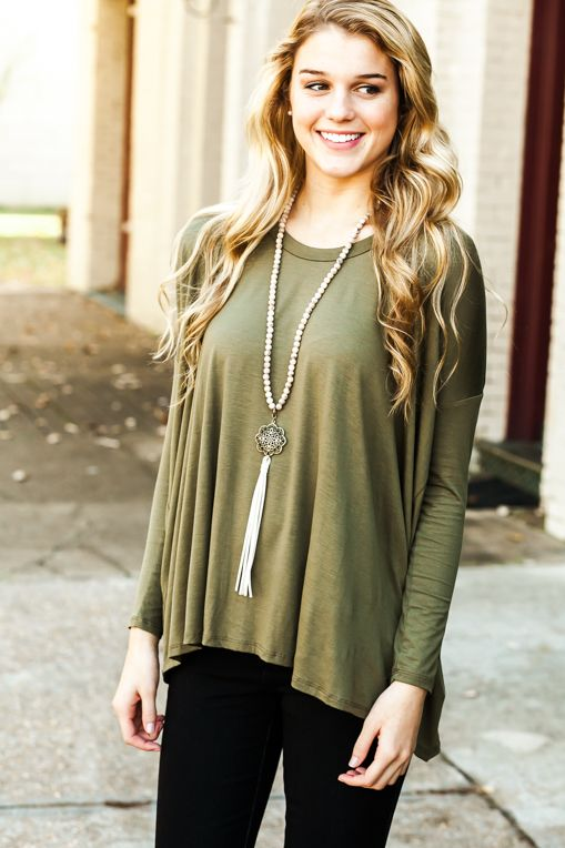 Trust us; you'll never want to take off your new favorite green long sleeve top, and there's no reason you should have to!