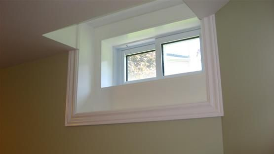 For those small, tight basement windows, this is a nice way to make it feel larger and brighter