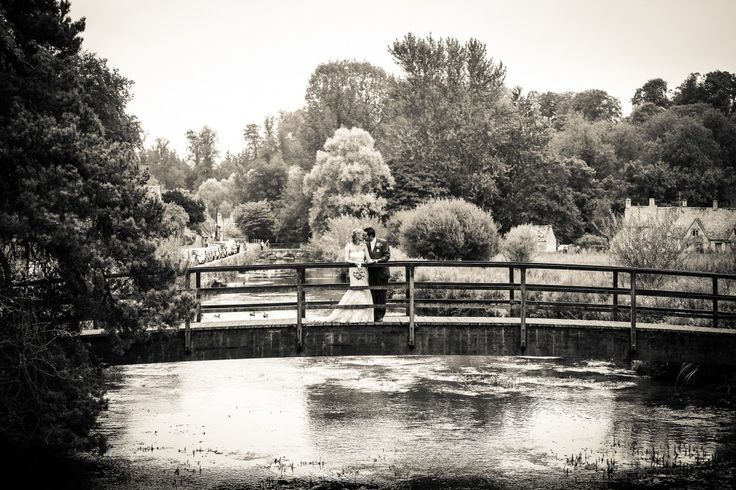 Wedding photography on a bridge over the River Coln at Bibury
