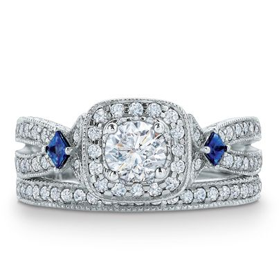 Set into the bezel are two princess-cut blue sapphires, a symbol of everlasting love. Different. Love it!