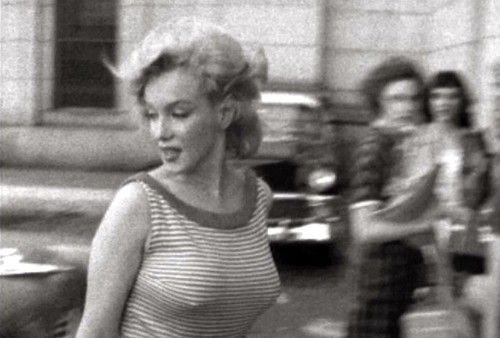 Marilyn Monroe in NY.... a very candid shot. look at the girls in bakcground staring.