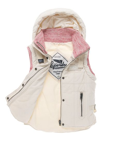 Superdry women's hooded Patrol gilet. A classic quilted hooded gilet featuring zip and popper front fastening, jersey inner collar and arm trim. This gilet also has two side pockets, a single inside pocket, embroidered Superdry shoulder logo and a chest logo badge.