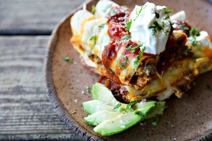 Overnight Taco Breakfast Enchiladas are the happy marriage of breakfast egg bakes, taco flavours, and enchiladas all together in one convenient, delicious package that is assembled the night before it bakes, leaving you to dream of satisfying, hearty breakfasts with no more work than sliding a pan in the oven!