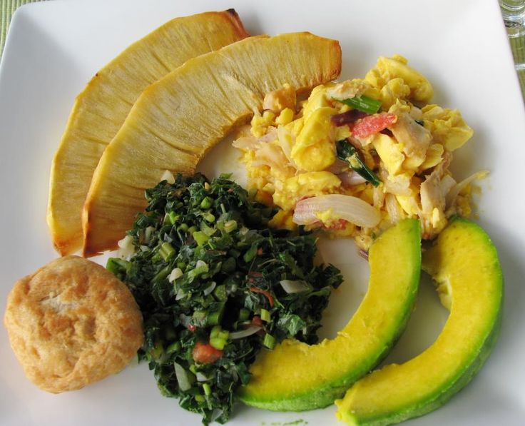 Jamaican ackee and saltfish with fried breadfruit, callaloo, fried dumpling and avacado