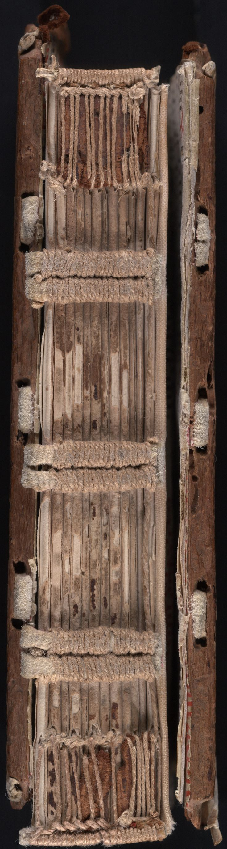 This Gothic manuscript is a Confessionale written on paper in Florence, Italy, circa 1500 CE. The original binding consists of sewing on three tawed, slit straps, laced through tunnels in the edges of wooden boards into rectangular channels on their outer face. Twisted, tawed cores of plain, wound endbands are laid in grooves. All supports pegged and filled in, possibly with gypsum. Beinecke Library, MS 4 (Yale University, New Haven , CT). Use of image permitted for academic purposes.