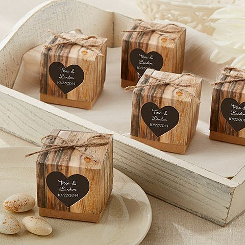 Reminiscent of carved initials on a tree, rustic faux-wood favor boxes include stickers custom printed with the bride and groom's name and wedding date.