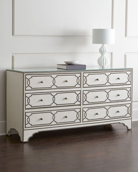 """Dresser made of select hardwoods. Clear lay-on glass with eased edge on top. Linen-wrapped surfaces outlined and studded with nailhead trim. Six drawers. 64.75""""W x 20.125""""D x 33.25""""T. Imported. Boxed"""