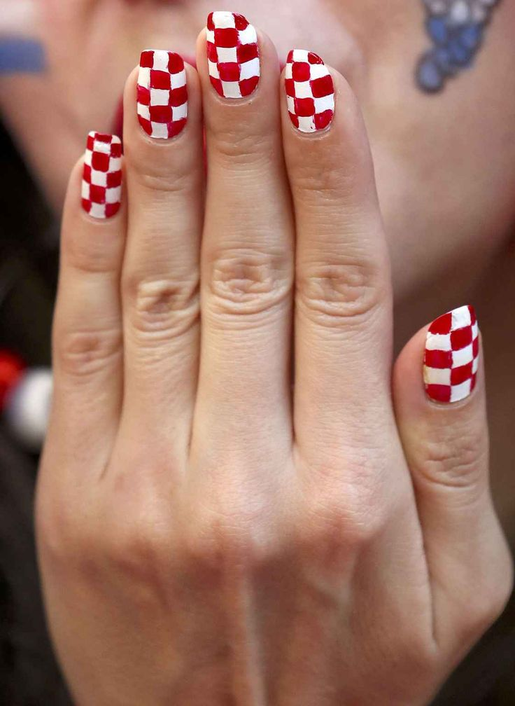 A Croatian supporter sports her fingernails painted in the colors of the Croatian national flag, as she waits for the start of the Euro 2016 Group D soccer match between Croatia and Spain at the Nouveau Stade in Bordeaux, France, Tuesday, June 21, 2016. (AP Photo/Hassan Ammar)/LKW113/23122900241/1606212057