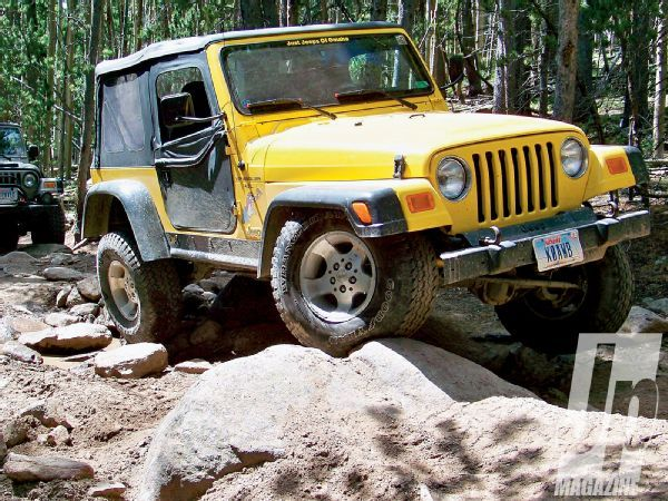 154 1008 10 Best Jeeps Of All Time 2000 To 2004 Tj Yellow Front View Photo 28773401