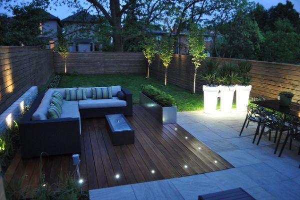 This is another beautiful example of a deck with built-in floor lights that are used simply to set an intimate mood but that are complemented by stronger lights that provide a very strong focal point and that provide enough light for both the outdoor living area and dining space. led-deck-lighting