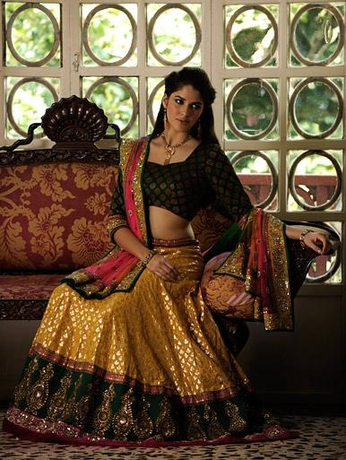Banarasi woven lehenga with zardozi and sequin work along the border accompanied by a shaded net dupatta and contrasting blouse