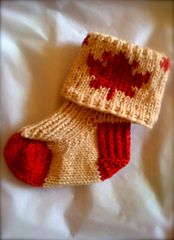 Ravelry: Little Maple Leaf Baby Socks pattern by Clare Lawrence-Moody