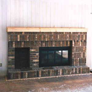 The before photo: the 70s house with brick fireplace against paneling