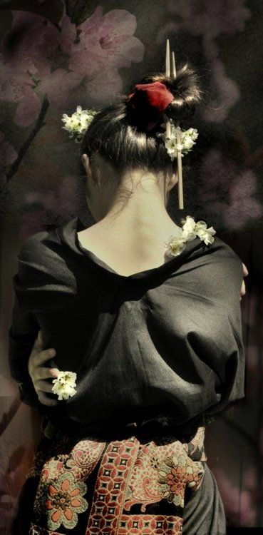 Tomesode and obi - the nape of a woman's neck is considered very sensual and beautiful in the Japanese culture. Kimonos are designed to draw attention to the neck with upswept hair.