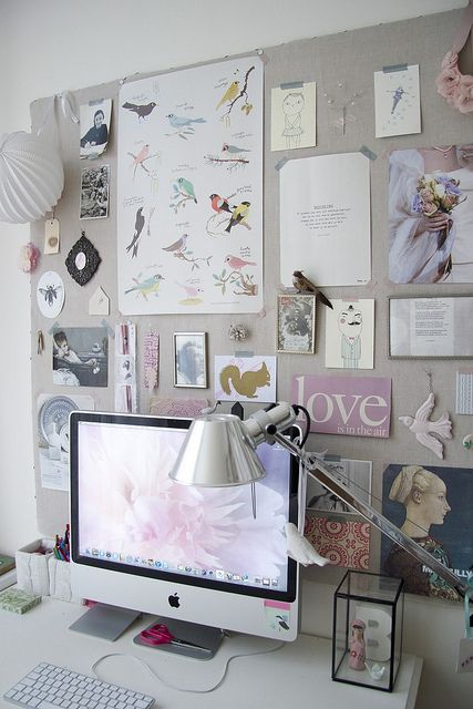 I like the idea of a mood board/bulletin board behind a computer in an office space.
