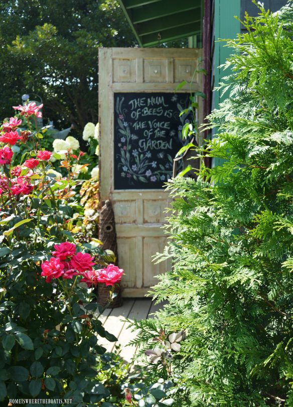 Chalkboard door on Potting Shed: The Hum of Bees is the Voice of the Garden   homeiswheretheboatis.net #flowers #sheshed