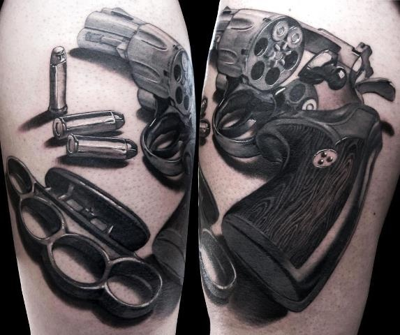 Pretty kick ass realism tattoo. Flawless lines, highlights, and shadows. Check out the wood grain. Even if you aren't a gun fan, this tattoo is phenomenal. -BirdY