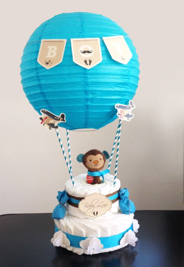 Monkey Diaper cake - Adding the balloon on top is a nice touch - Baby shower gifts and crafts