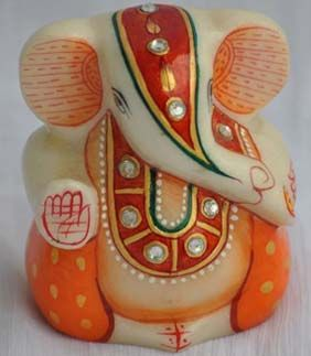This Lord Ganesha idol is made of white marble that has a sheen. This idol is decorated with hand paintings to provide an artistic look on your table or showcase.http://handicrafts.exoticabazaar.com/view/5958-7-lord-ganesha.html