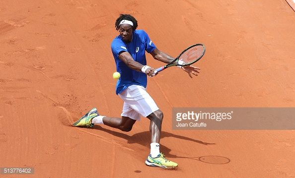 Gael Monfils of France in action against Frank Dancevic of Canada during day 1 of the Davis Cup World Group first round tie between France and Canada at Stade Velodrome Amedee Detraux on March 4,...