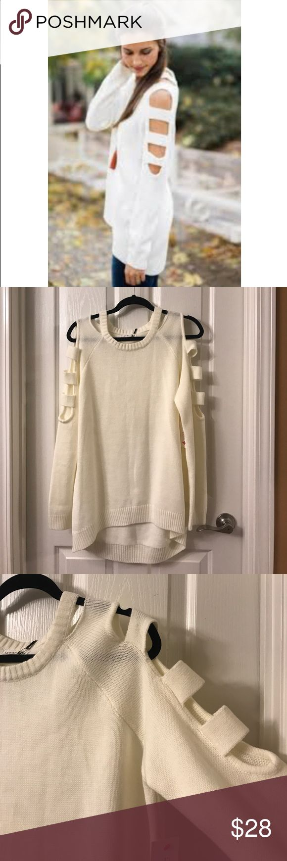 Red Dress Boutique Ivory Sweater with Cutouts Ivory sweater with cutouts down the sleeve. Size medium. New with tags. Never worn. I've included a picture (sorry for low quality - it was the only one I could find) of a model wearing the garment to show the fit. The Red Dress Boutique Sweaters Crew & Scoop Necks