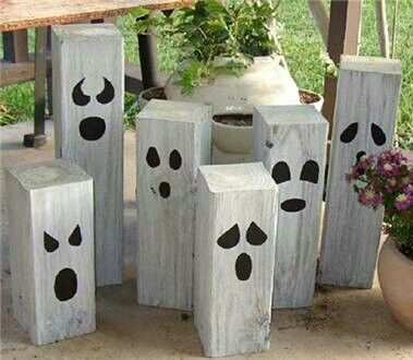 Halloween Jack-o-landern faces on 4x4 lumber - easy DIY lawn decoration