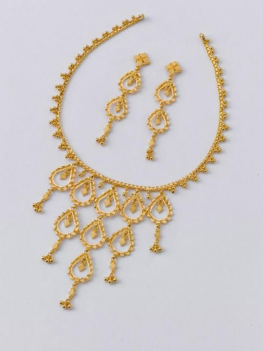 Necklace - 8.000 gms, Rs. 27,650/- Earring - 2.200 gms, Rs. 7,700/-