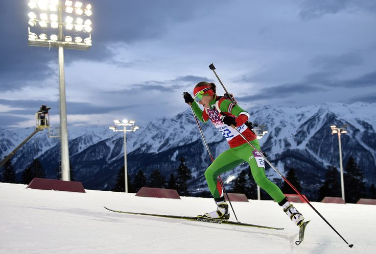 Sochi 2014 Olympics: Reaching the podium - Darya Domracheva of Belarus in action during the Women's Biathlon 7.5km Sprint competition at the Laura Cross Biathlon Center on Feb. 9. (Hendrik Schmidt/EPA) #
