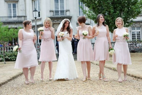 This is the look I'm considering going for with my bridesmaids. The same color but a different shape to each dress. Mine will be lavender instead of pink. :)