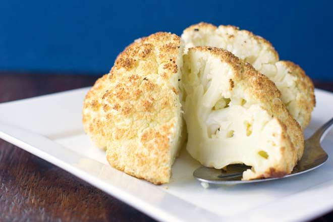 Roasting a whole head of cauliflower is really easy. The result is not only delicious but is really gorgeous to serve at the table. You're going to love this one!