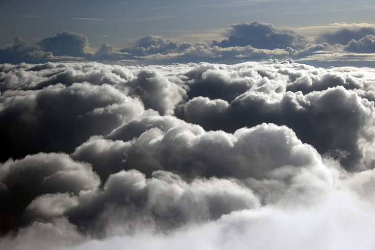 My seat is above a sea of clouds and I can see a nice part of the world through the window