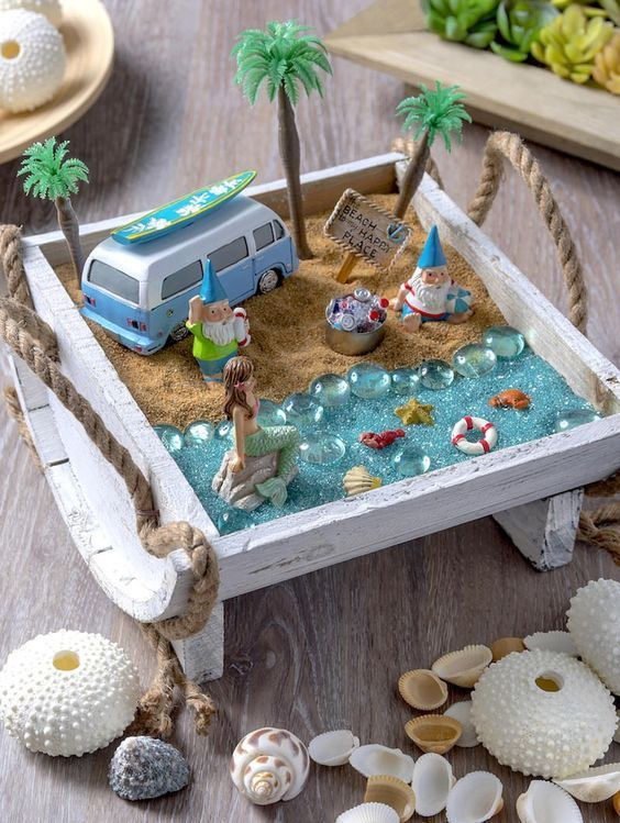 Create your own beach fairy garden and bring a sense of seaside enchantment to your home or outdoor space. It's so easy to put together! MichaelsMakers Mod Podge Rocks