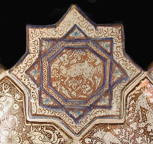 Star-Shaped Tile  Object Name:Star-shaped tile  Date:14th century  Geography:Iran  Culture:Islamic  Medium:Stonepaste: inglaze painted in blue and turquoise and luster-painted on an opaque white glaze  Dimensions:8 x 8 in. (20.3 x 20.3 cm)  Classification:Ceramics-Tiles  Credit Line:Gift of Rafael Guastavino, 1928  Accession Number:28.89.4