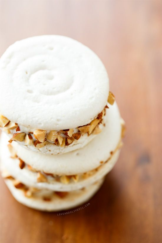 Almond Macaron Ice Cream Sandwiches with vanilla bean almond ice cream and crunchy chopped almonds.
