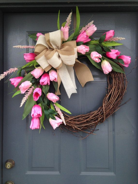 Beautiful spring tulip wreath with large burlap bow. If pink is not your color, a custom wreath can be made with the color of your choice.
