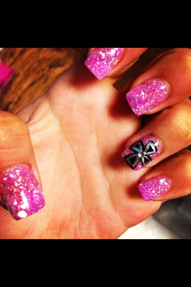 Pink glitter solar nail with cross design