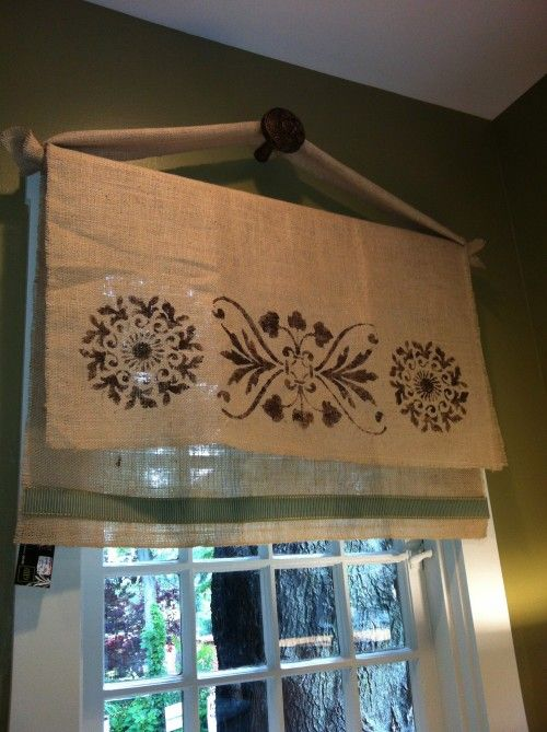 Stenciled Burlap window treatment for laundry room window...  or any type fabric.  Makes a different look for top of windows