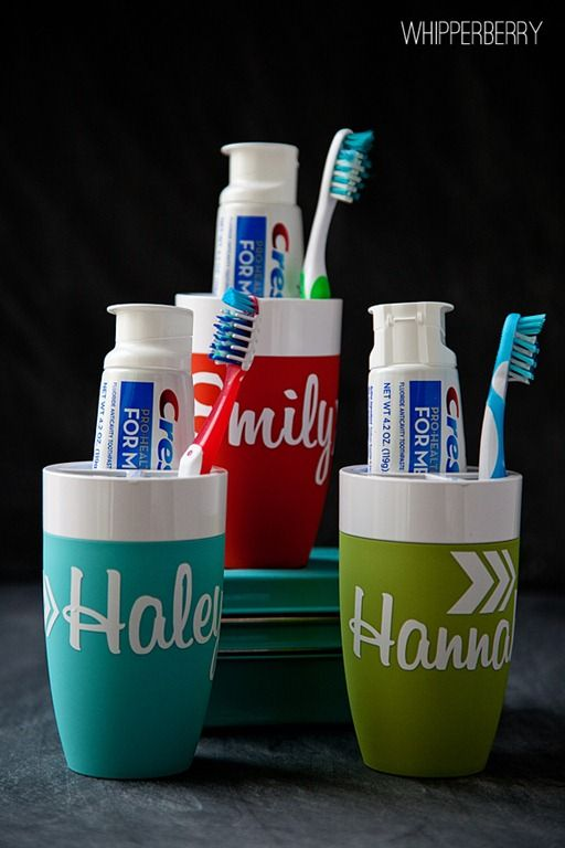 Personalized tooth brush holders : just what i need for our bathroom.. We all have dif. Toothpaste this will be great!