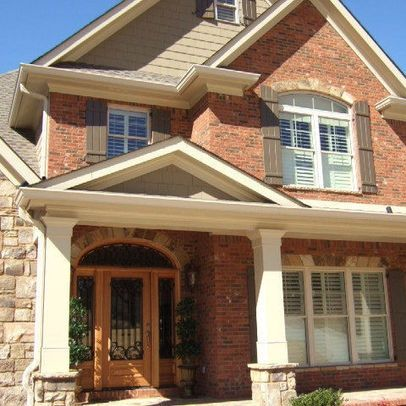 Brown brick homes white trim tan siding with red orange Front door color ideas for brick house