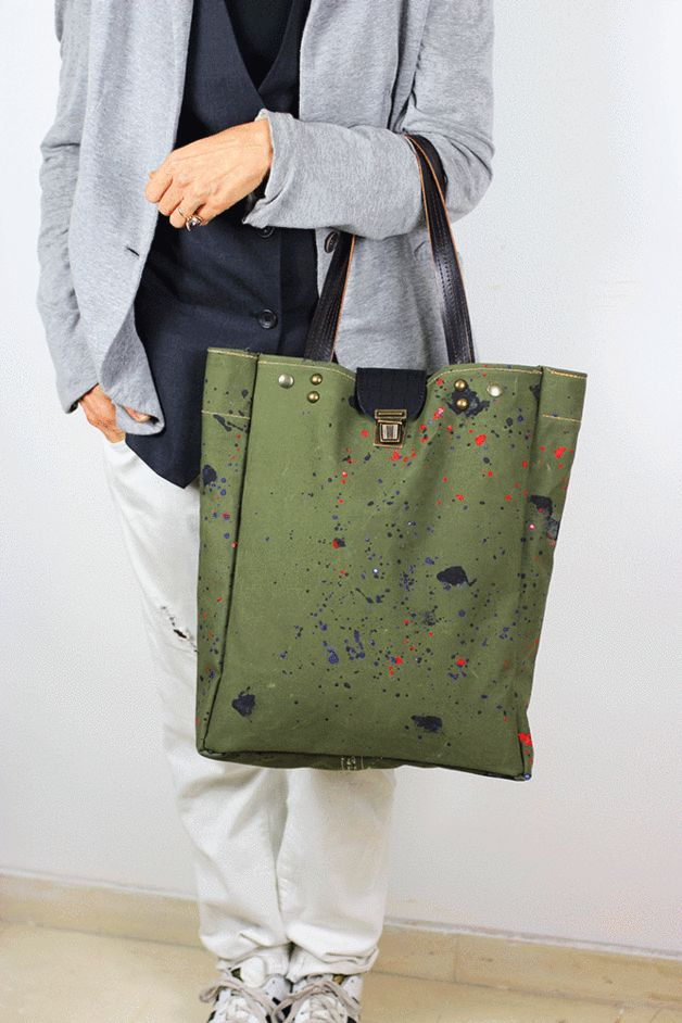 One of a kind tote bag handcrafted with upcycled canvas from a military tent.  The canvas is hand painted by me, features a paint splatter design.  I use non-toxic paint which is sealed for...