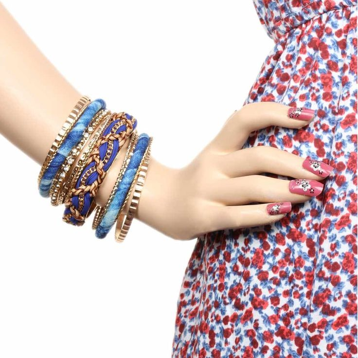 Grab this alluring set of bangles and get ready for any special gathering or occasion. This bangle set is beautifully designed with studs and crystals around it and braided lace gives it an appealing look. The design is really awesome. So, grab it and stack them up for maximum impact and make females around you envious.  Visit for buy this Stylish Bangle set:- http://khoobsurati.com/khoobsurati/blue-toned-bangle-set-khoobsurati