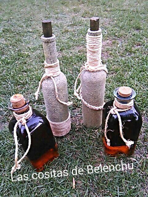 Botellas pintadas  y decoradas...con un poco de cuerda.....